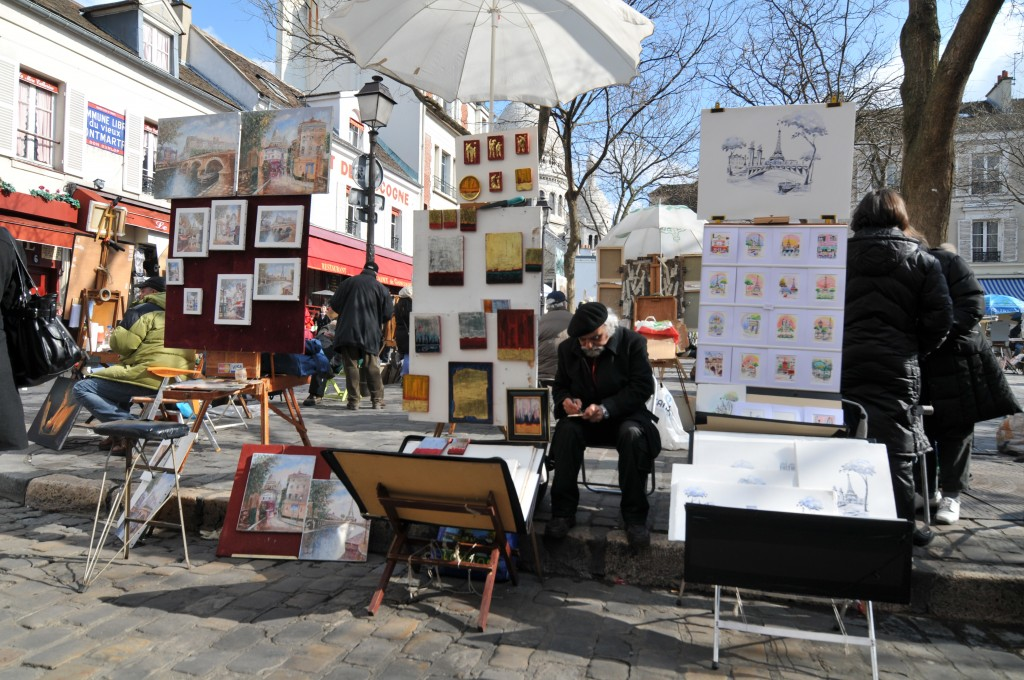 Place du Tertre Painters_at_Montmartre_By Serge Melki (Flickr Painters at Montmartre) [CC BY 2.0 httpcreativecommons.org licenses by 2.0 ], via Wikimedia Commons